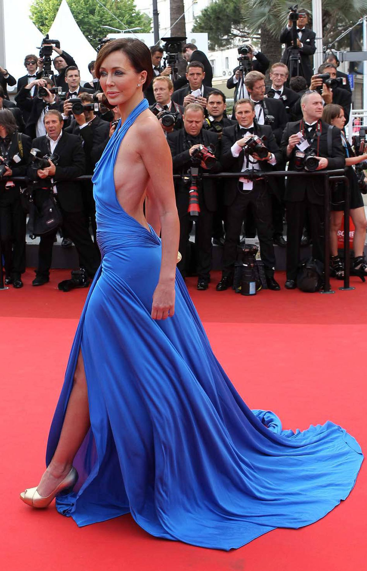 """Photographers at the Cannes Film Festival did not recognize this woman on the red carpet for the screening of """"Habemus Papam,"""" identifying her only as """"a guest,"""" yet they still felt strangely compelled to take her picture."""