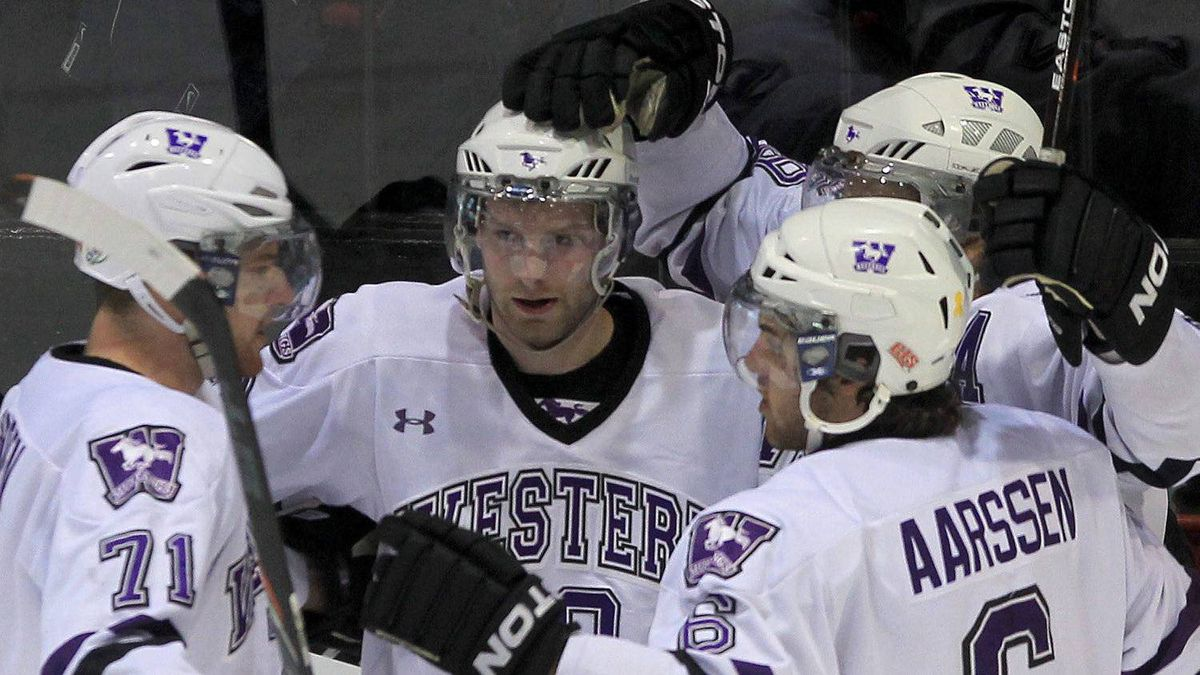 Western Mustangs Kevin Baker (10, middle) celebrates a goal with his team during first period action against the UQTR Patriots at the 2012 Canadian Interuniversity Sport men's hockey championships in Fredericton, New Brunswick. Western won the game 3-2 in overtime. THE CANADIAN PRESS/Mike Dembeck.