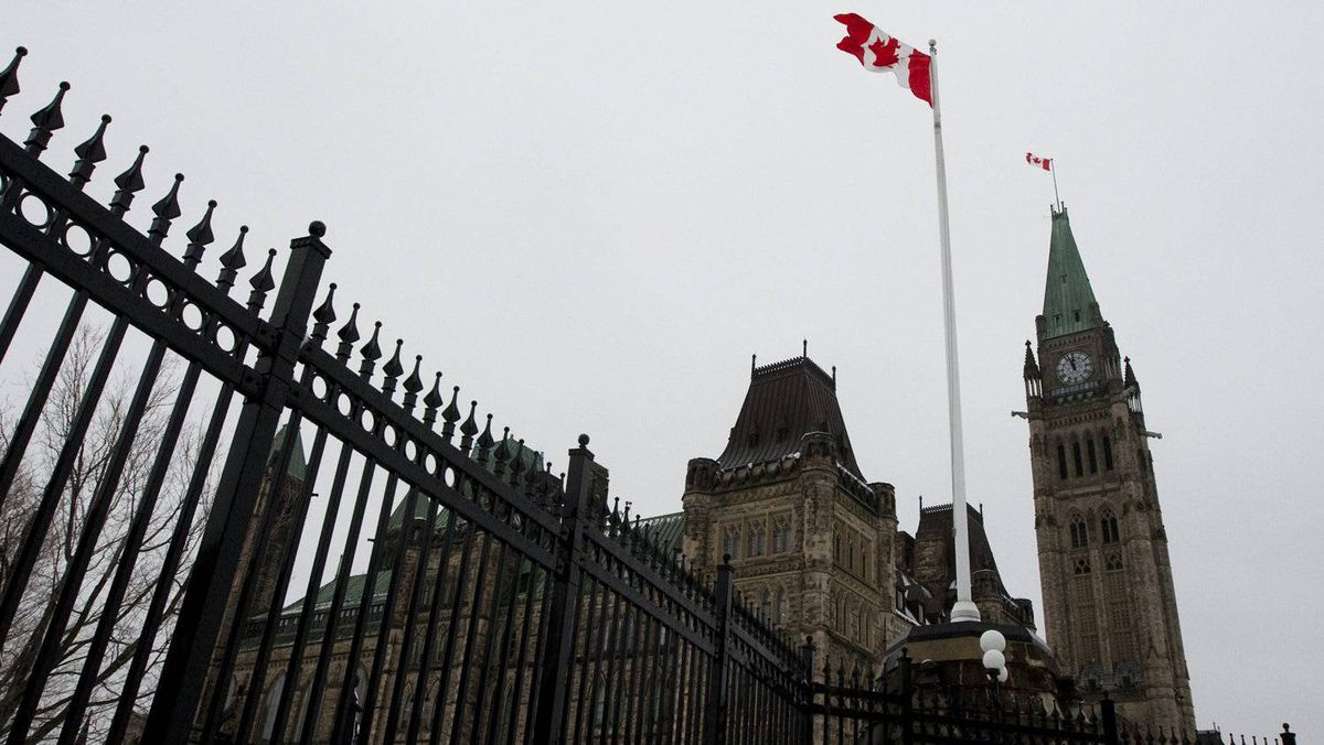 A Canadian flag flies over Parliament Hill in Ottawa on Monday, March 21, 2011.