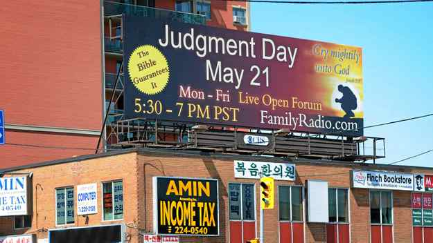 The U.S.-based evangelical group Family Radio has bought 2,000 ads around the world, including this one on Yonge Street in Toronto, warning of the end of the world.