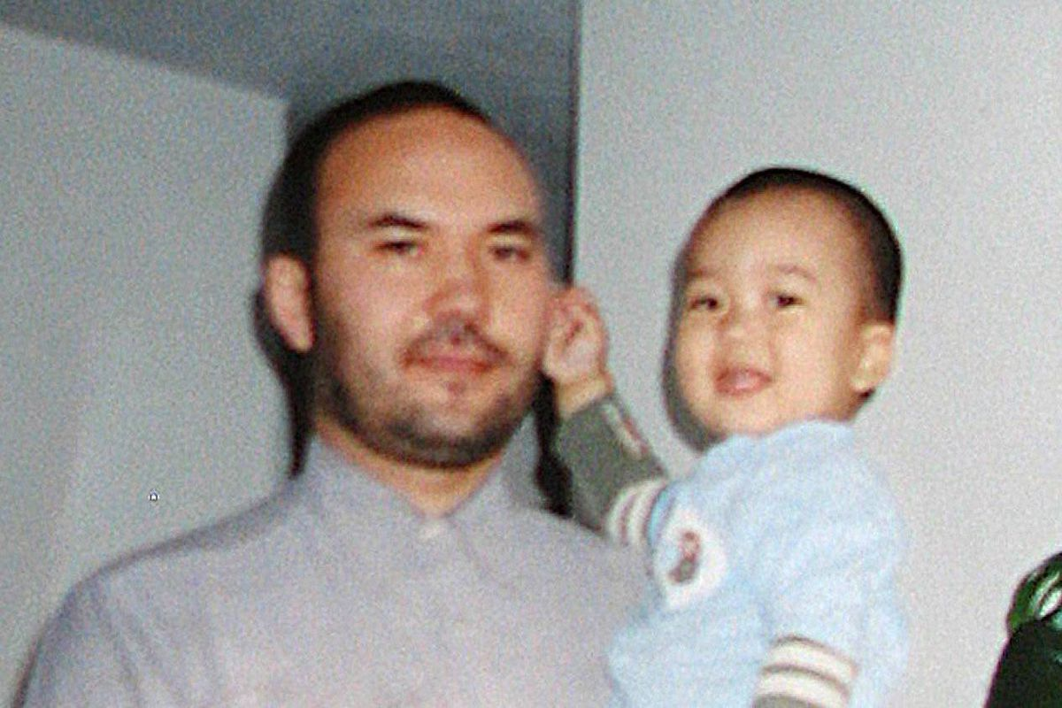 Huseyin Celil and one of his youngest children in a photo taken shortly before his arrest in 2006.