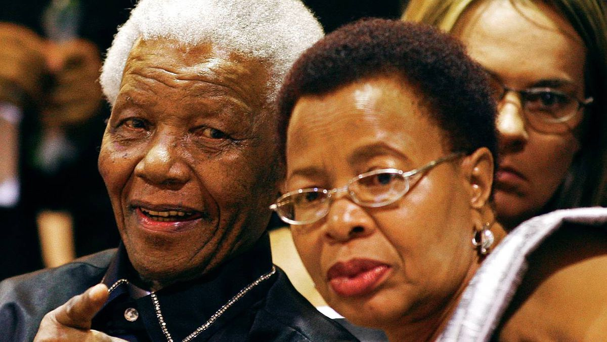 Former South African president Nelson Mandela and his wife Graca Machel sit in the gallery at the opening of Parliament in Cape Town on Feb. 11, 2010.