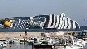 The luxury cruise ship Costa Concordia leans on its starboard side as seen from the Giglio harbor, after running aground off the tiny Tuscan island of Giglio, Italy, Saturday, Jan. 14, 2012. The luxury cruise ship ran aground off the coast of Tuscany, sending water pouring in through a 160-foot (50-meter) gash in the hull and forcing the evacuation of some 4,200 people from the listing vessel early Saturday, the Italian coast guard said. The number of dead and injured is not yet confirmed Coast Guard Cmdr. Francesco Paolillo said.