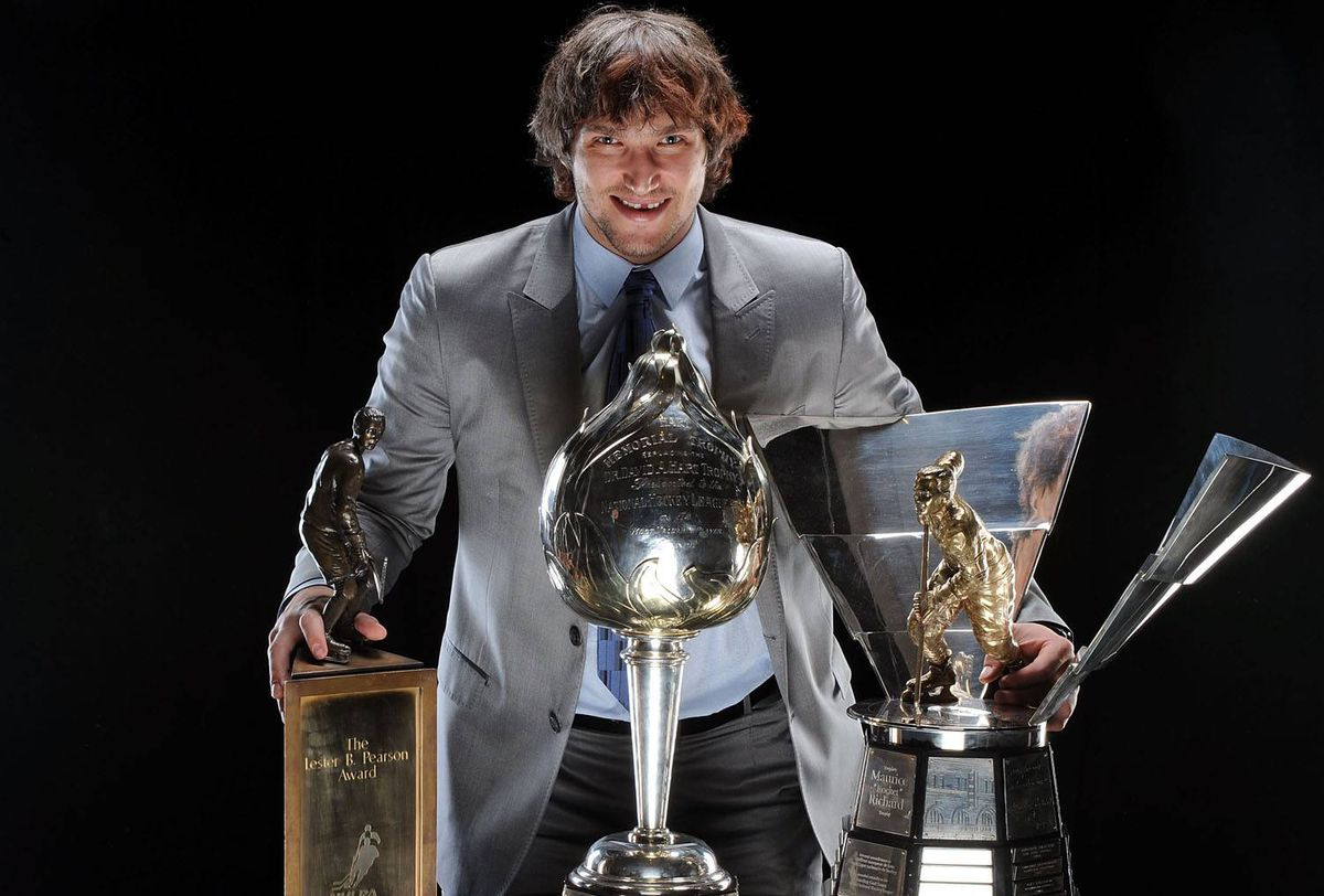 Alexander Ovechkin of the Washington Capitals poses with the Lester B. Pearson Award, the Hart Trophy and the Maurice Richard Trophy following the 2009 NHL Awards at the Palms Casino Resort.