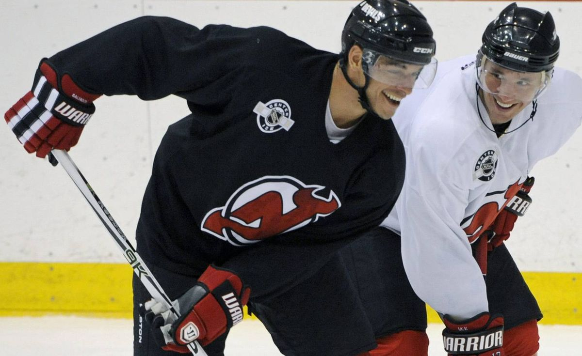 New Jersey Devils' Ilya Kovalchuk, right, and Bryce Salvadore smile during practice as the Devils prepare for the NHL hockey season Saturday, Sept. 18, 2010 in Newark, N.J. (AP Photo/Bill Kostroun)