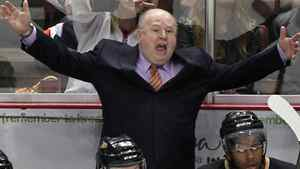 Anaheim Ducks coach Bruce Boudreau, center, has words for an official as an apparent Ducks goal is waived off in the third period of an NHL hockey game against the Boston Bruins in Anaheim, Calif., on Sunday, March 25, 2012. The Bruins won 3-2. (AP Photo/Christine Cotter)