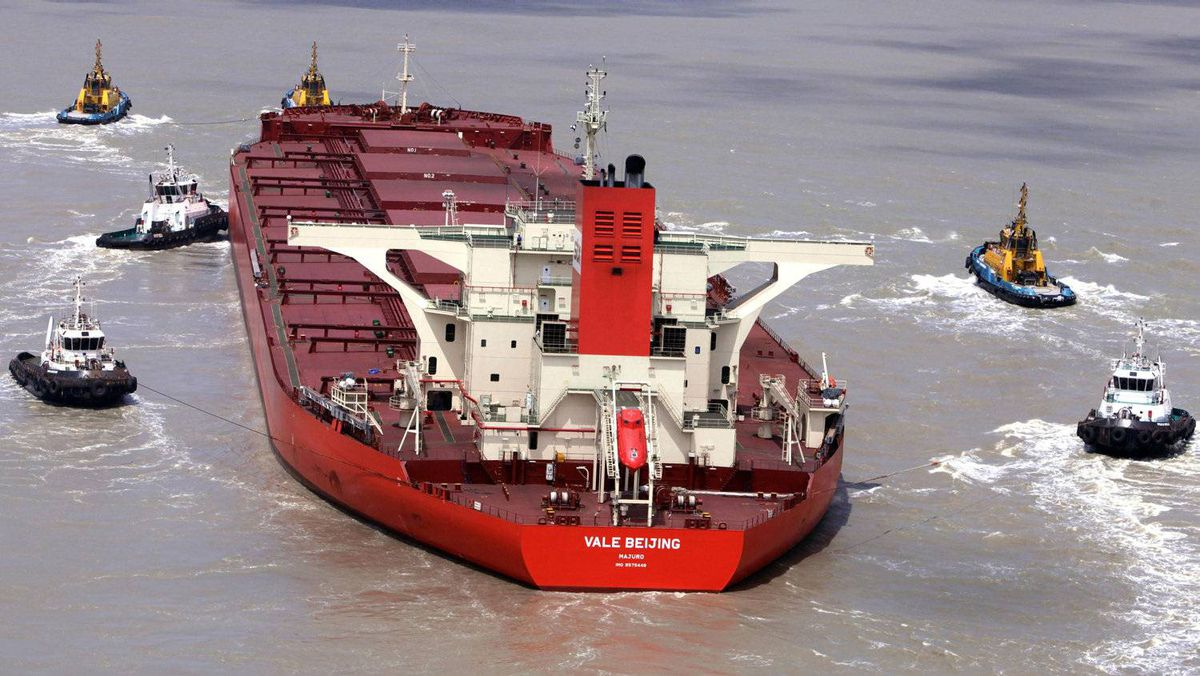 Tugs move the damaged the Vale Beijing, a 361-metre-long vessel that is loaded with 384,300 tonnes of iron ore, at Ponta da Madeira Port in Brazil.