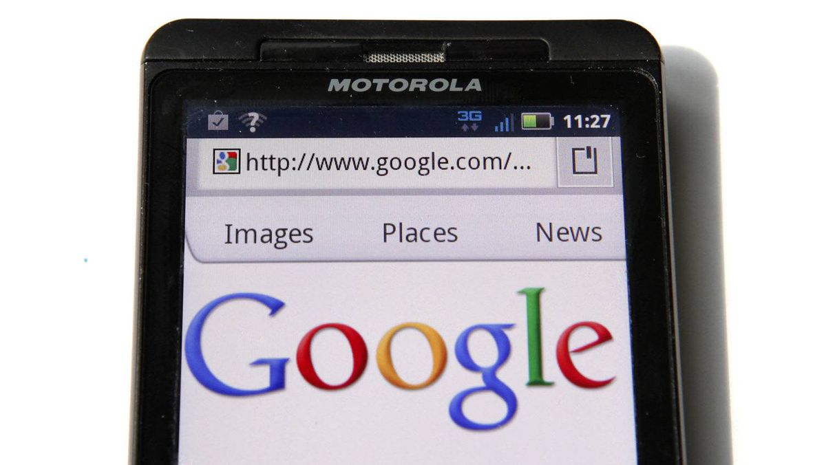 A Google homepage is displayed on a Motorola Droid phone in Washington in this August 15, 2011 file photograph.