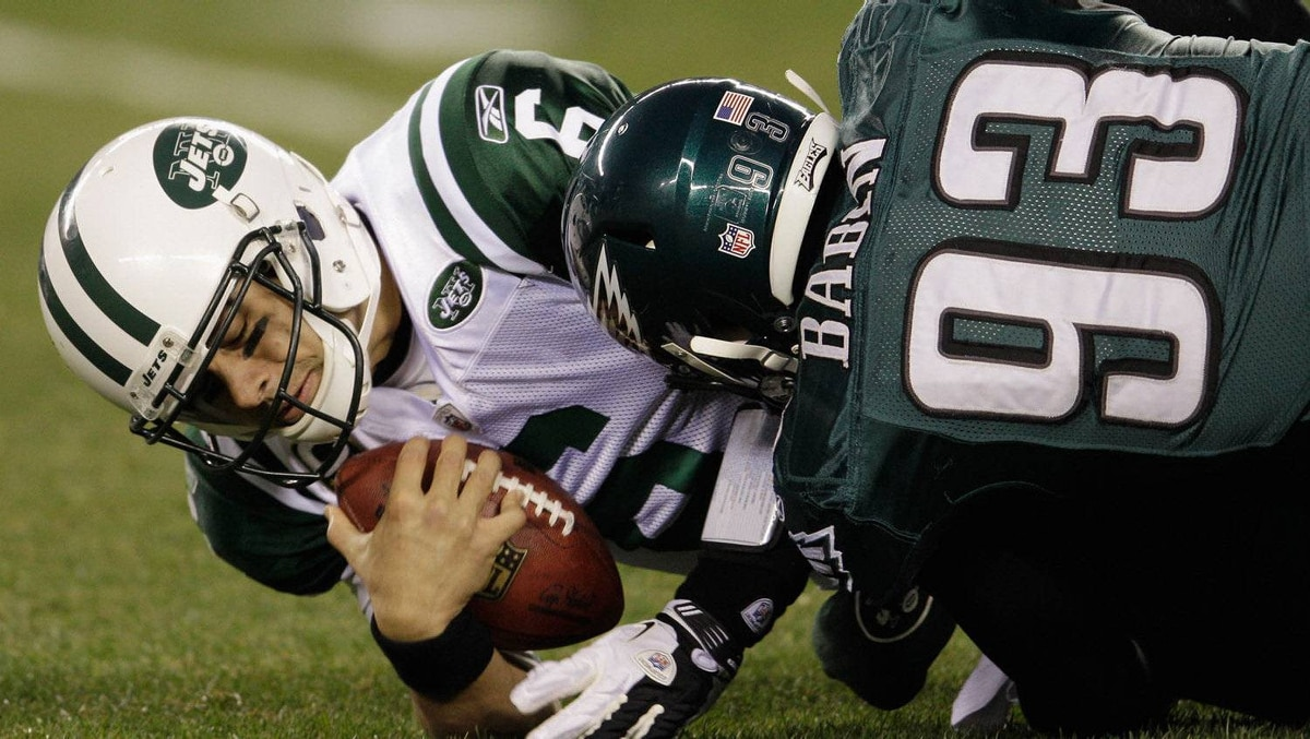 Mark Sanchez #6 of the New York Jets is sacked by Jason Babin #93 of the Philadelphia Eagles during the first half at Lincoln Financial Field on December 18, 2011 in Philadelphia, Pennsylvania. The Eagles won 45-19. (Photo by Rob Carr/Getty Images)