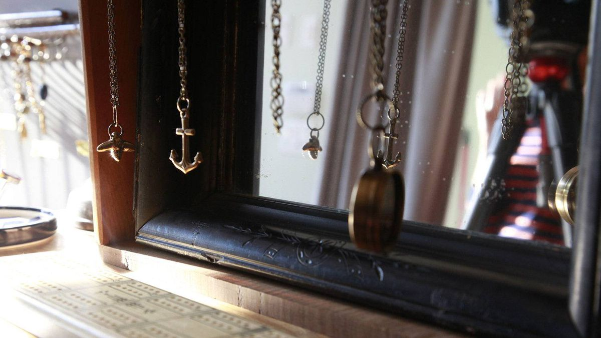 Pendant necklaces hang at the Arthur vintage decor shop in Toronto