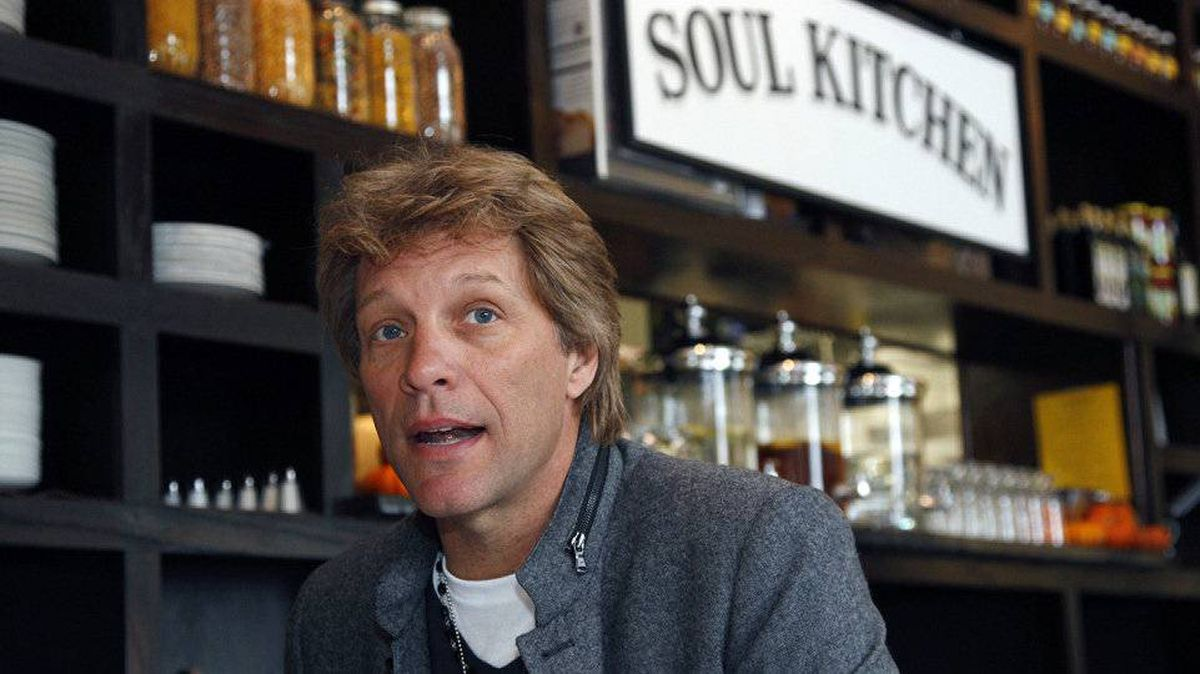 Rock star Jon Bon Jovi sits in the Soul Kitchen restaurant in Red Bank, N.J., Wednesday, Oct. 19, 2011. Diners pay whatever they're able to.