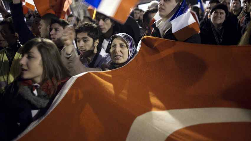 Turks demonstrate in front of the French National Assembly, at dawn on Dec. 22, 2011 in Paris.