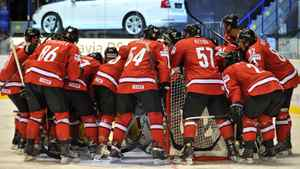 Swiss players regroup during the IIHF Ice Hockey World Championship group B match between Switzerland and Belarus.