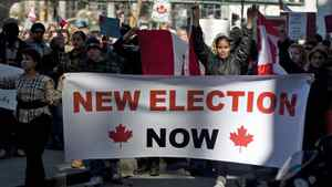 Protesters take the streets in downtown Toronto on March 11, 2012 in response to the widening robo-call election scandal.
