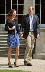 The day after the wedding, the newlywed wore an $89 Zara dress while walking hand-in-hand with her new husband outside Buckingham Palace.