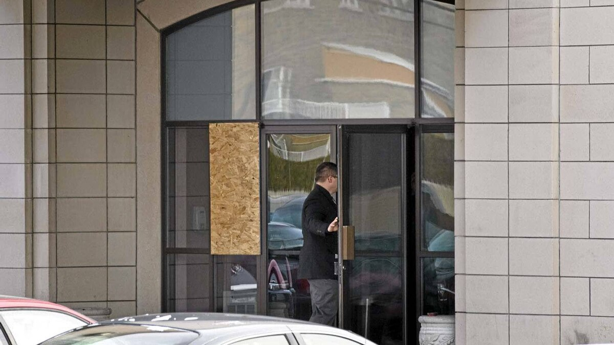 A man enters a funeral home owned by the Rizzuto family that was firebombed overnight Thursday, January 6, 2011 in Montreal.