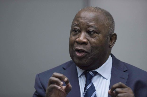 f5d56c4703720 Former Ivory Coast President Laurent Gbagbo gestures as he enters the  courtroom of the International Criminal Court in The Hague on Jan. 15