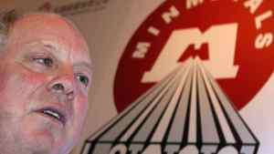 Minmetals Resources chief executive officer Andrew Michelmore attends a news conference in Hong Kong April 4, 2011.