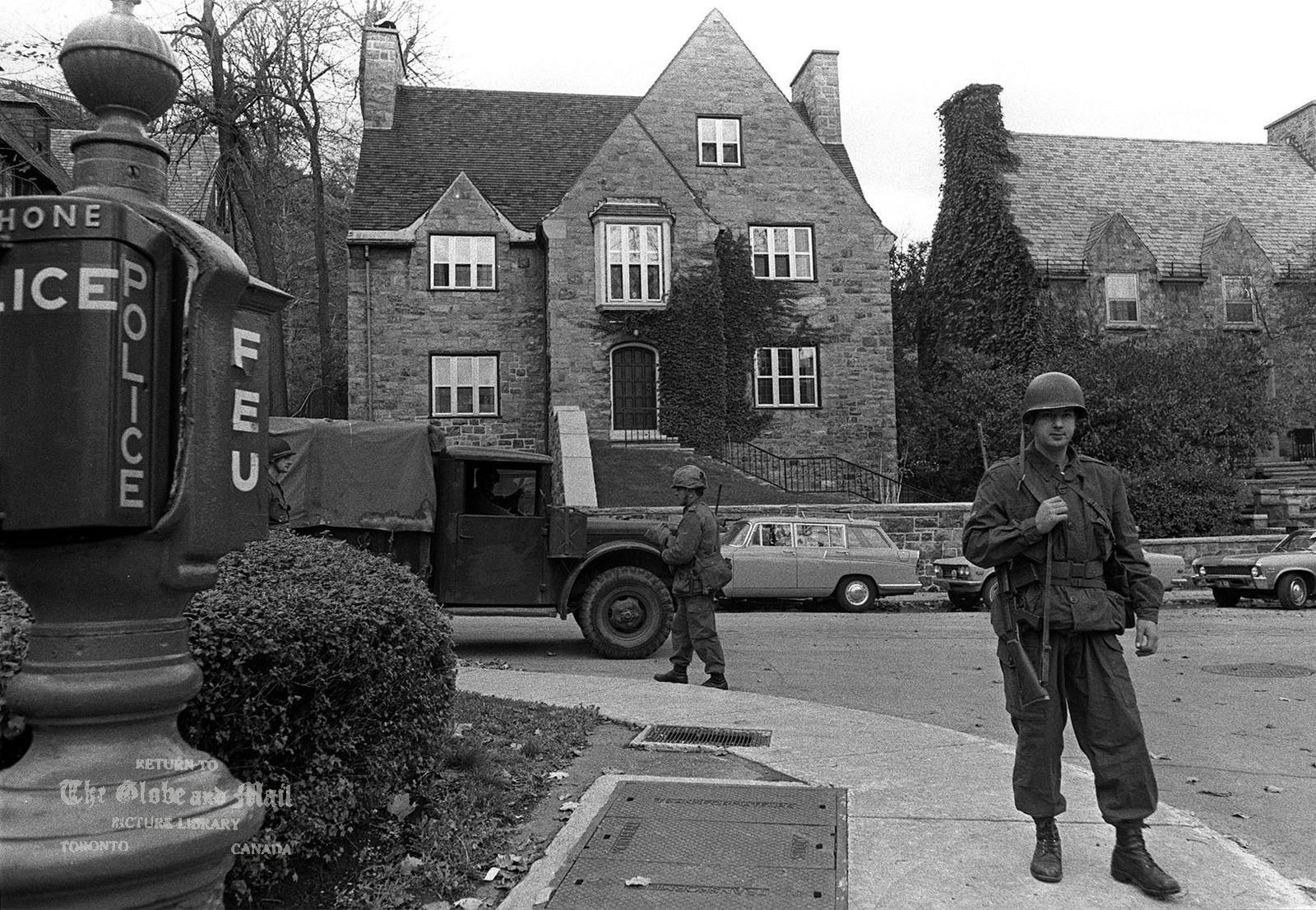 The notes transcribed from the back of this photograph are as follows: FILE--Soldiers take over guard duty, Oct. 16, 1970 at the Montreal home of British Trade Commissioner James Cross, one of the two political hostages whose kidnapping by the FLQ has brought on the use of the war emergency act measures in Canada, never before used during peace. (CP PICTURE ARCHIVE)