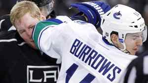 Vancouver Canucks' Alexandre Burrows (R) elbows Los Angeles Kings' Matt Greene in the face as the teams scuffle after Greene scored a goal during the second period of an NHL hockey game in Los Angeles December 31, 2011. REUTERS/Danny Moloshok