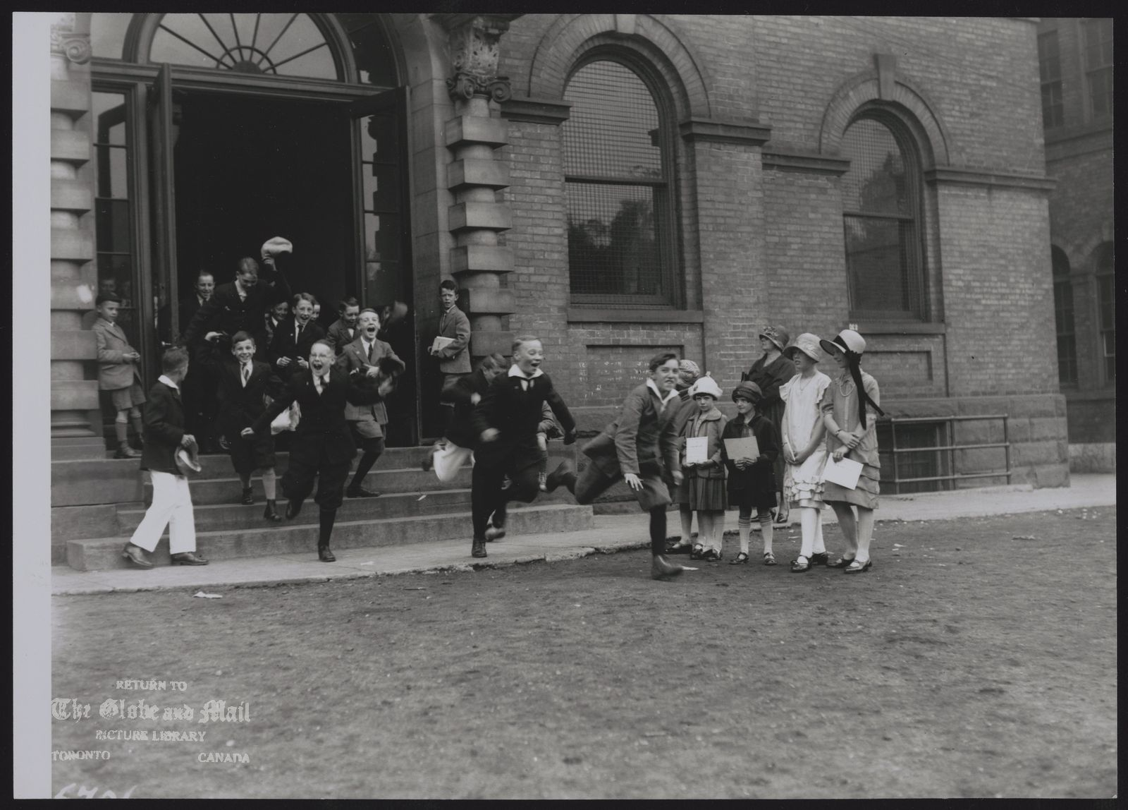 EDUCATION HISTORICAL STUDENTS LEAVING TORONTO NORMAL MODEL SCHOOL FOR HOLIDAYS IN 1925.