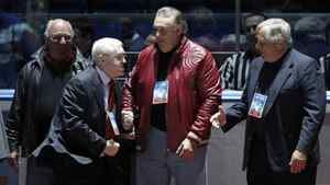 Russian legendary hockey player Boris Mikhailov jokes, right, with former Canadian hockey players Phil Esposito, centre, Dennis Hull, left, and Brad Park during the starting ceremony for an exhibition game in Moscow on Feb. 25, 2012 between teams of Russian and world stars to mark the anniversary of U.S.S.R.-Canada 1972 Summit Series.