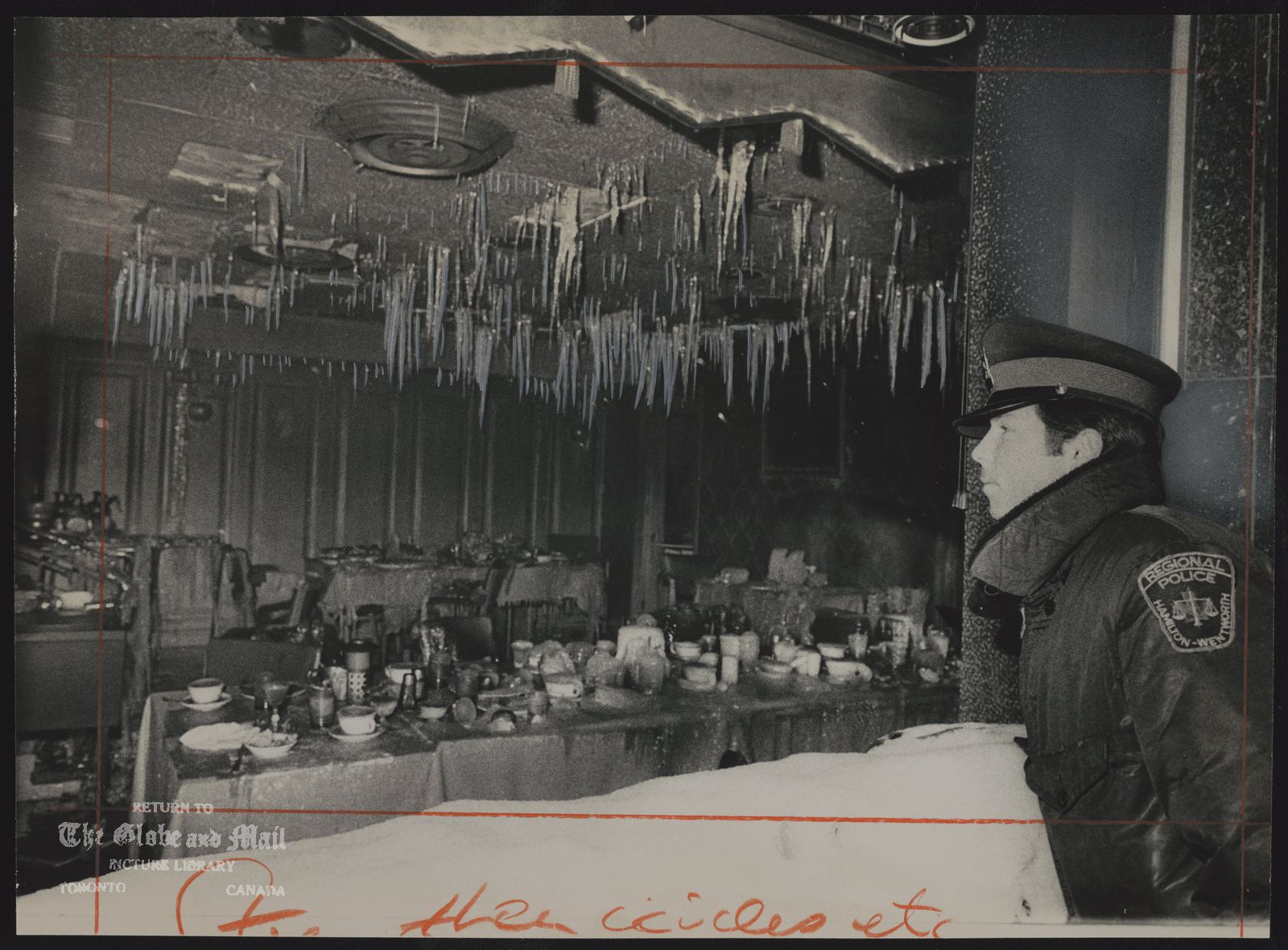 WENTWORTH ARMS HOTEL (Hamilton) Police Constable Brian Mullan, on duty at Hamilton's Wentworth Arms Hotel, is outside the icicle-festooned dining room of the hotel, which was gutted by a fire that killed six people on Christmas Day. The unsafe shell of the building is to be demolished.