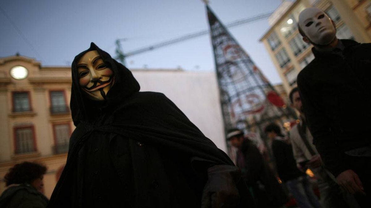 "WikiLeaks supporters wear masks of the ""Anonymous"" internet activist group and a mask of WikiLeaks founder Julian Assange during a demonstration calling for the release of Assange, in Malaga, southern Spain December 11, 2010."