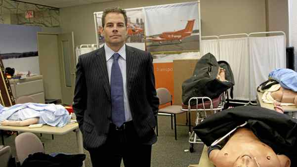 Dr. Chris Mazza, former CEO of Ornge, a company that provides emergency helicopter service in Ontario, poses at the training room of the company's headquarters in Toronto on Oct. 27, 2008.