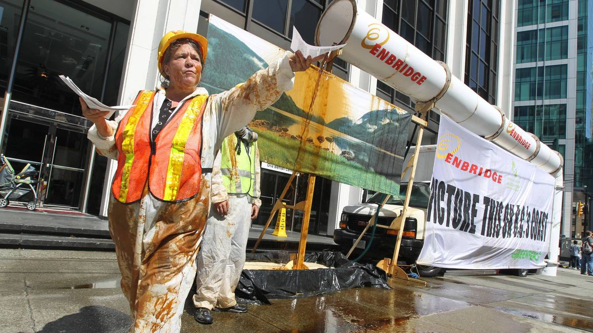 Greenpeace activists this summer protest outside Enbridge offices in Vancouver against the company's Gateway pipeline project.