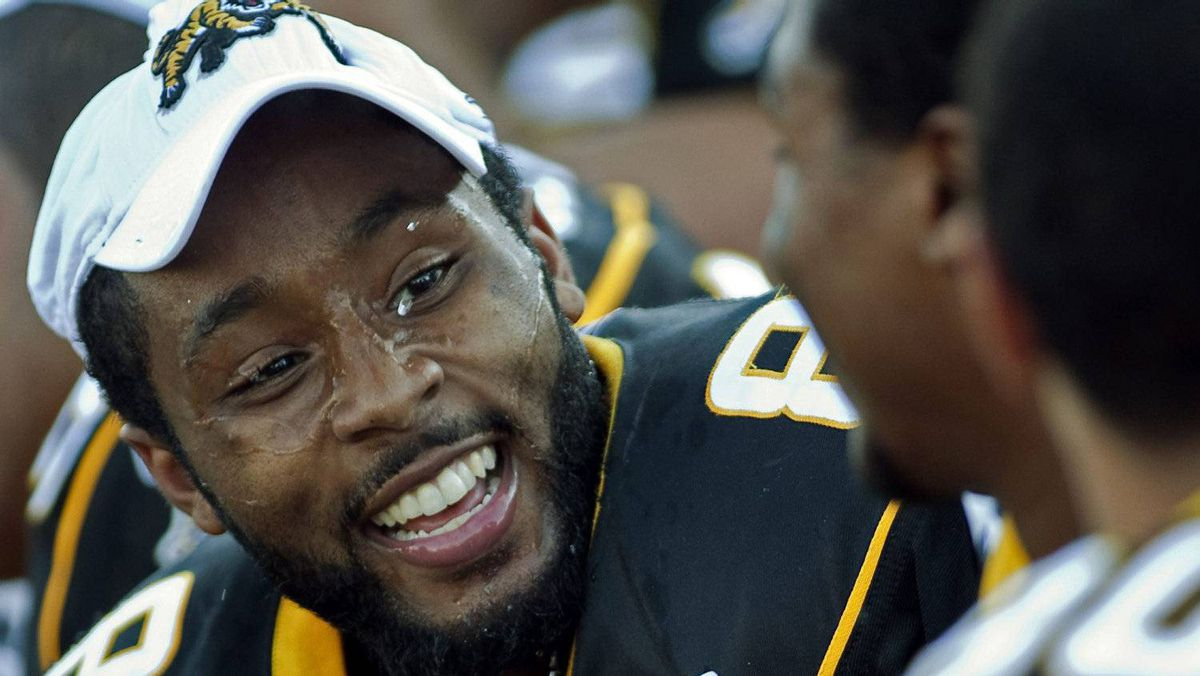 Hamilton Ti-Cats Marcus Thigpen sports a smile on the bench as they play the Calgary Stampeders in CFL action in Moncton, N.B. on Sunday, Sept. 25, 2011. Thigpen scored three touchdowns in Hamilton's 55-36 victory.THE CANADIAN PRESS/Andrew Vaughan