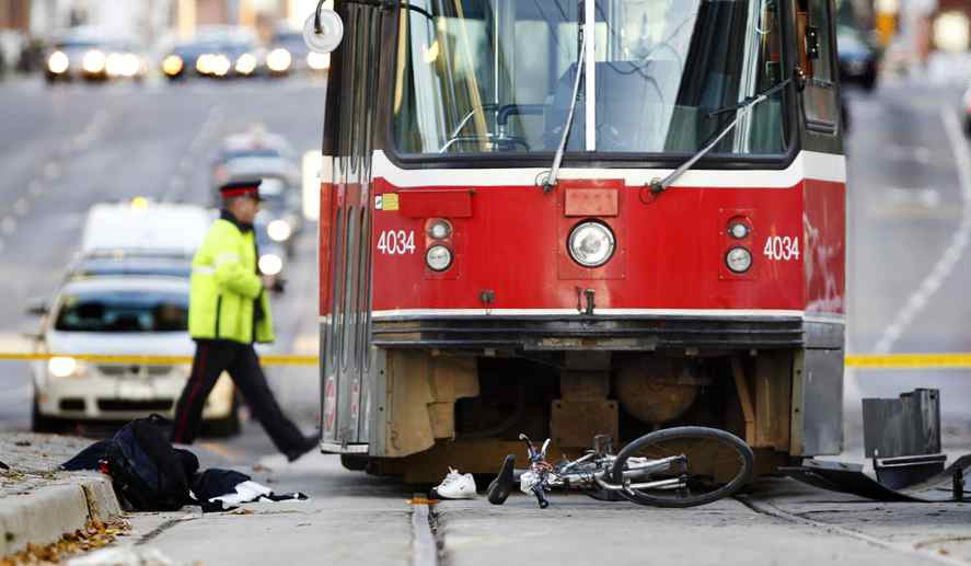 The scene of a fatal collision involving a cyclist and a TTC streetcar in Toronto on Friday morning.