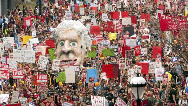 Students carry an effigy of Quebec Premier Jean Charest as they march through the streets of downtown in a massive protest against tuition fee hikes Thursday, March 22, 2012 in Montreal.