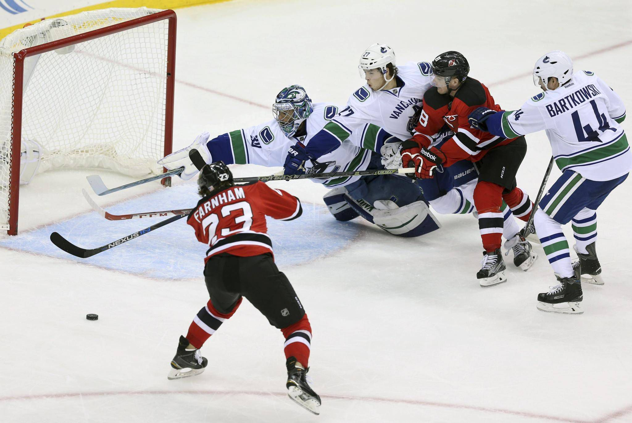 Kyle Palmieri scores in OT and Devils overcome Canucks rally