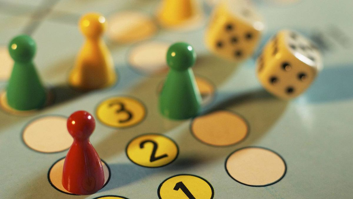 Close-up of ludo boardgame with dice. Shot in studio with Phase One.