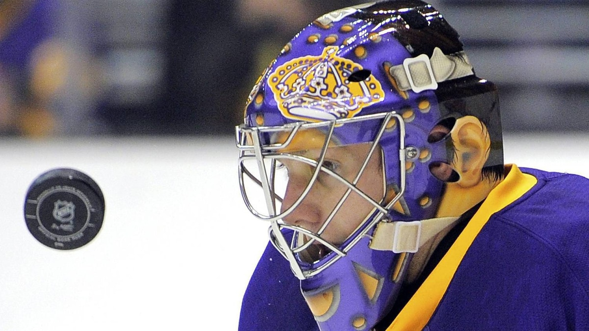 Los Angeles Kings goalie Jonathan Quick eyes the puck before stopping a shot on goal during the first period of their NHL hockey game against the Calgary Flames, Saturday, Feb. 18, 2012, in Los Angeles. The Flames won 1-0. (AP Photo/Mark J. Terrill)