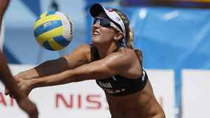 Canada's Heather Bansley sets the ball in a women's beach volleyball quarterfinal match against Brazil at the Pan American Games in Puerto Vallarta, Mexico, Wednesday Oct. 19, 2011.
