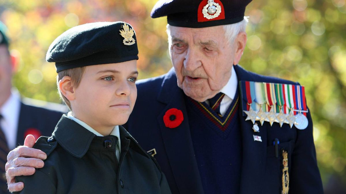 Veteran Bob Kennedy chats with Army Cadet Tristen Garnhum, 12, after the Remembrance Day ceremony in London, Ont., Thursday, Nov. 11, 2010.