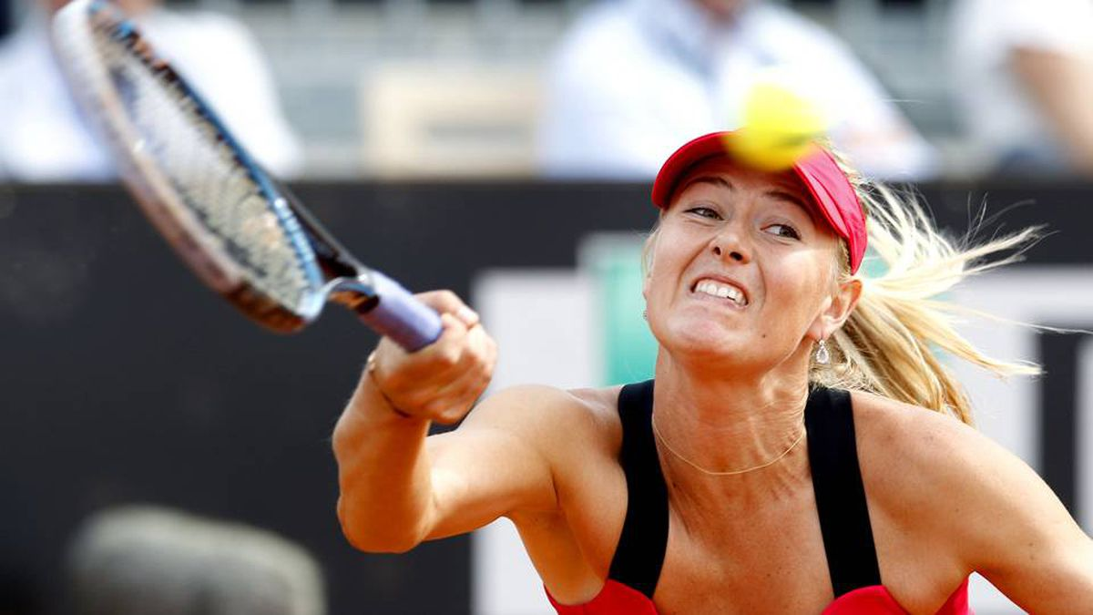 Maria Sharapova of Russia returns the ball to Venus Williams of the U.S. during their match at the Rome Masters tennis tournament May 18, 2012.