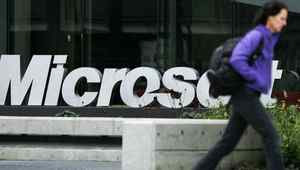 A person walks past a Microsoft sign on January 22, 2009 in Redmond, Washington.