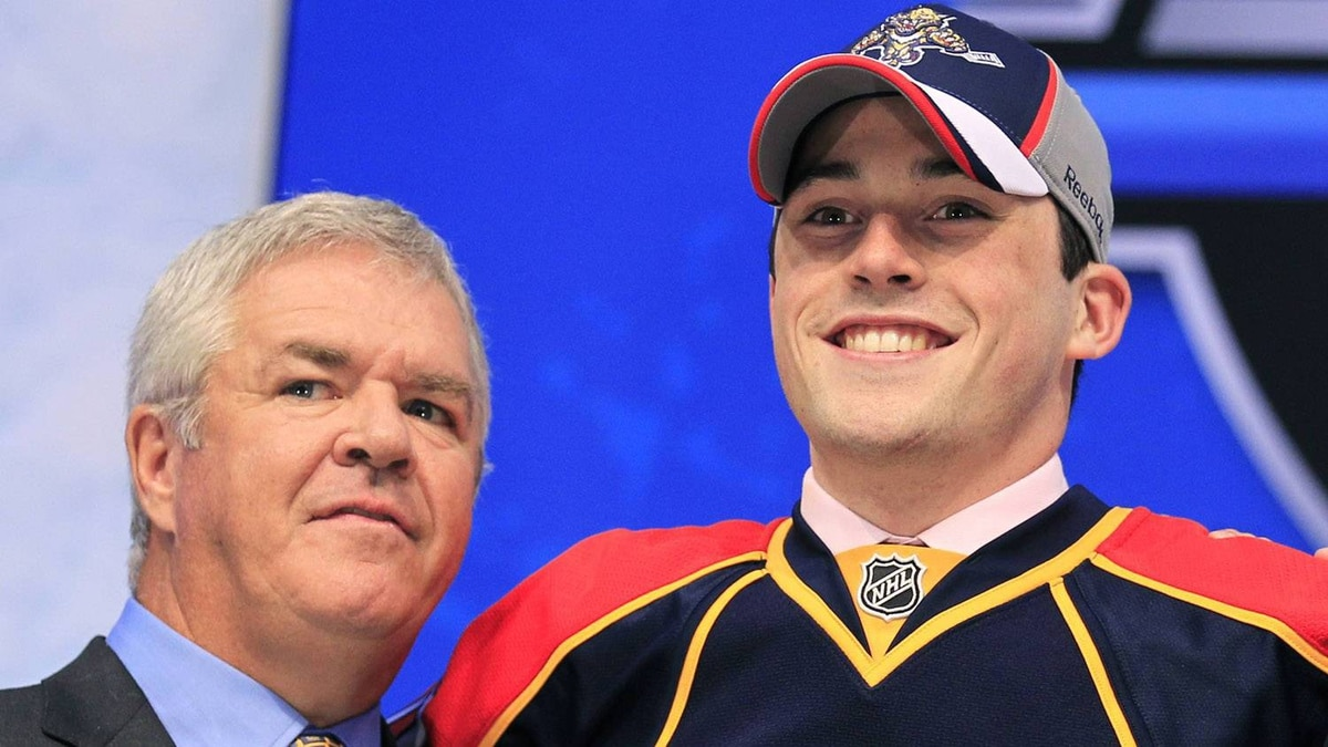 Florida Panthers' General Manager Dale Tallon (L) is seen with Erik Gudbranson during the first round of the 2010 NHL hockey draft in Los Angeles, California June 25, 2010.REUTERS/Mike Blake