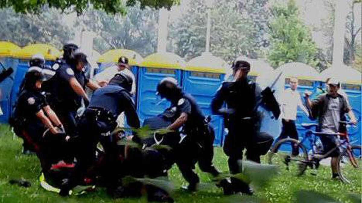 A handout photograph showing the arrest of Adam Nobody during G20 protests in Toronto.