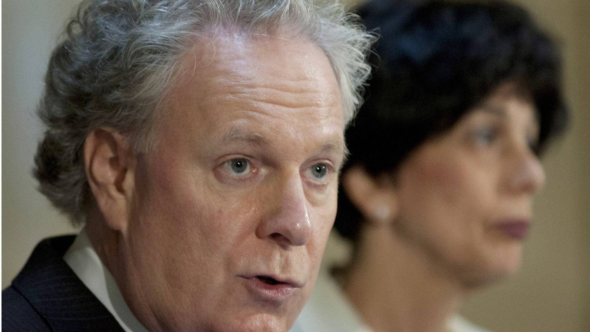 Quebec Premier Jean Charest explains the reasons for leaving a negotiation table with student leaders as Education Minister Michelle Courchesne, right, looks away at a news conference at the Premier's office at the legislature in Quebec City on Thursday, May 31, 2012.