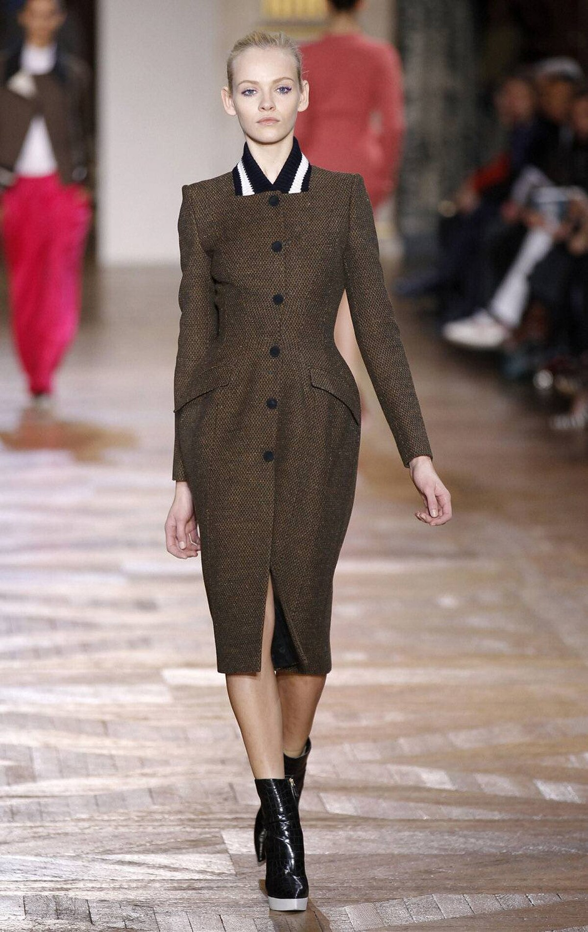 Tweed coat, meet varsity jacket. Here, McCartney hits the uptown-downtown sweet spot. Such a fresh twist aside, the hourglass shape confirms her knack for tailoring.