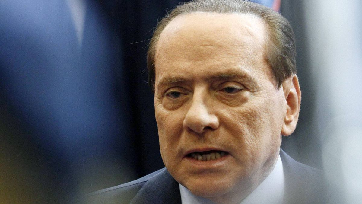 Italy's Prime Minister Silvio Berlusconi is interviewed at the end of an euro zone leaders summit in Brussels on Oct. 23, 2011.