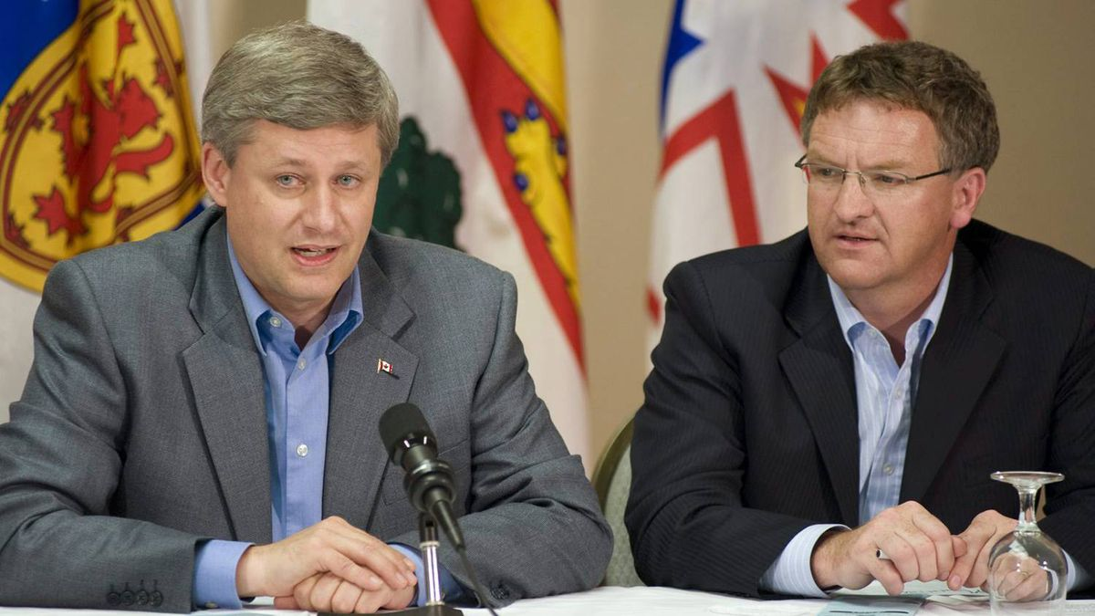 Prime Minister Stephen Harper, left, and Fabian Manning address the Conservative Atlantic Caucus in Fredericton on Aug.14, 2008.