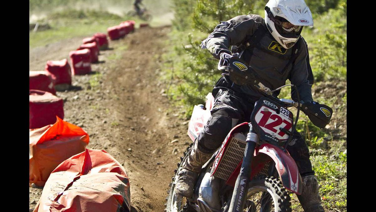 Ken Anderson tears around the a corner of the motocross track up at Apex during the 2010 Canadian Enduro Championships.