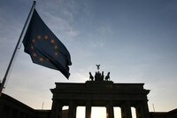 The sun sets behind Berlin's Brandenburg Gate as a EU flag flies. By purchasing 1.5 million square feet of office space for $568-million in Frankfurt, Hamburg, Munich, Cologne and Dusseldorf, Dundee has not only added to its portfolio, but also proven it is not constrained by a real estate market in Canada that has become fully valued