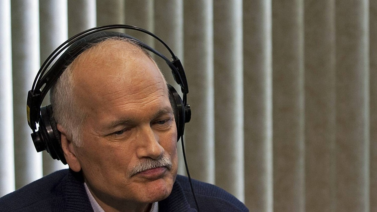NDP Leader Jack Layton listens to a caller as he participates in a phone-in radio show during a campaign stop in Kitchener, Ont. on March 29, 2011.