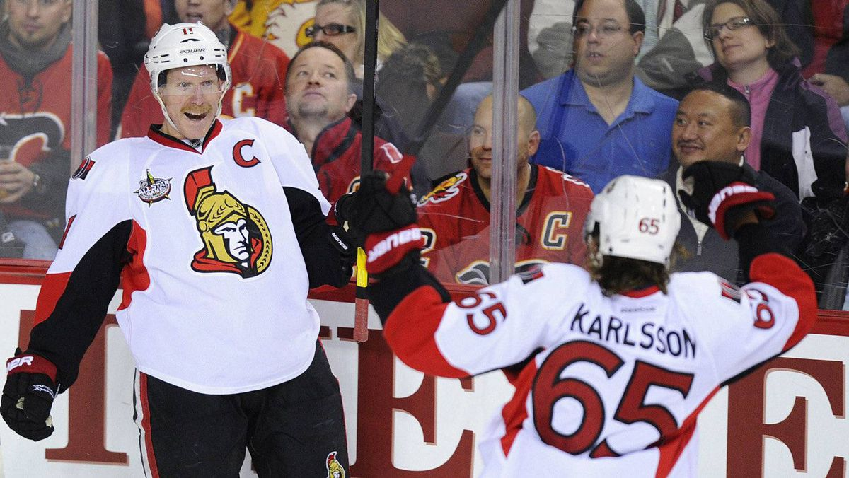 Ottawa Senators' Daniel Alfredsson (L) celebrates his goal with teammate Erik Karlsson during the second period of their NHL hockey game against the Calgary Flames in Calgary, Alberta, November 15, 2011.